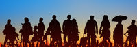 sihouette of group of people sunset sky background  -