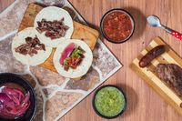 Carne Asada. Mexican barbecue tacos of beef