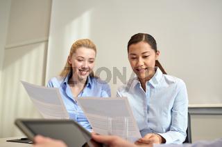 smiling businesswomen meeting in office