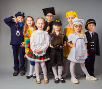 Happy friends dressed as doctor, cook, judge, policeman, agent fbi and singer.