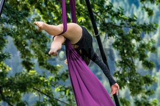 Talented woman performs aerial dance