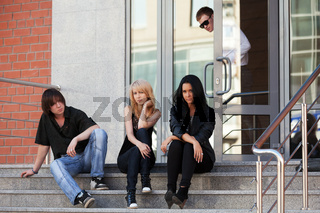 Young people sitting on the steps