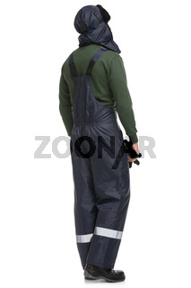 Man in work overalls isolated rearview