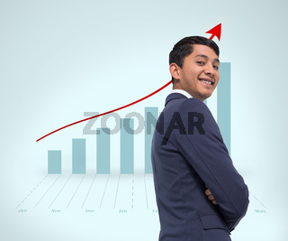 Composite image of smiling asian businessman with arms crossed