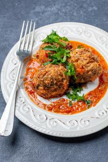Delicious homemade meatballs in tomato sauce.