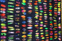 Colorful fishing lures on sale. Plug with hook. Set of different plugs for fishing. Colorful fishing