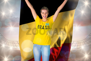Excited football fan in brasil tshirt holding belgium flag