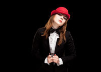 High fashion look. portrait of beautiful sexy young female woman with red lips on black background with hat