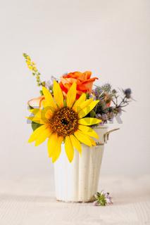 Colorful flowers in ceramic pot