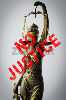 statue of Justice - sign no justice