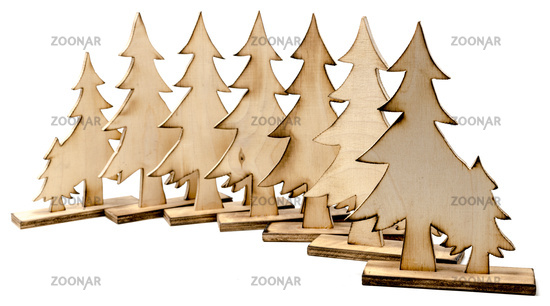 Cut out figure made of wood with dark edges and wooden fir trees isolated on white