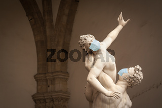 The Kidnapping of the Sabine Women Statue by Giambologna, in the Loggia dei Lanzi in Florence Italy With Face Masks - Coronavirus Scare