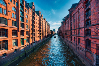 Hamburg, Germany - June 01, 2019: The famous Speicherstadt and its brick buildings build a perfect contrast with the waterway and the deep blue sky