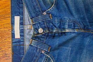 indigo jeans with a button