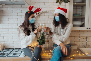 Two girls chatting, gossiping in the kitchen on new year's eve
