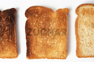 square slices of bread made from white wheat flour toasted in a toaster