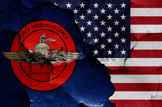 flags of United States Marine Corps Force Reconnaissance and USA painted on cracked wall