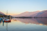 red boats on stunning mountain Iseo lake