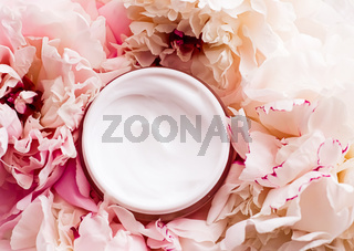 Luxe cosmetic cream jar as antiaging skincare routine product on background of peony flowers, body moisturizer and beauty branding