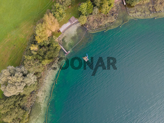 Drone shot over water. Background of lake. Birds view. Copy Space