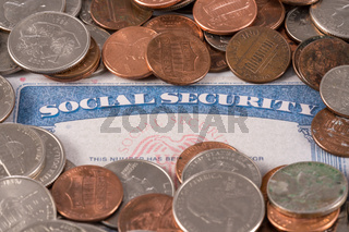 USA social security card overflowing with cash to illustrate budget crisis