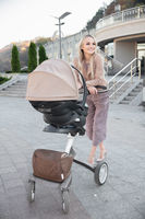 Beautiful mother with a pram