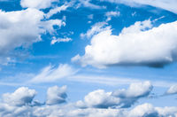 Blue sky background, white clouds and bright sunlight