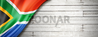 South African flag on old white wall banner