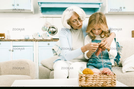 Grandmother and granddaughter knitting special seasonal gift for her mother
