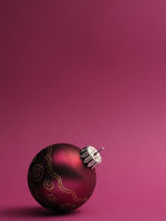 Purple vintage Christmas baubles on a purple background