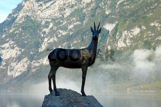 Bohinj, Slovenia, September 30, 2019: Lake Bohinj statue of gold horned chamois.