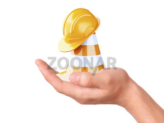 hand hold traffic cone. Under construction concept