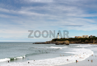 many surfers enjoy the waves on the Grand Plage in Biarritz