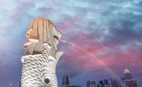 Singapore Merlion and city skyline at sunset