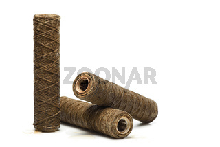 Set of used rope water filters on white with copy space. Clogged and dirty string water filters