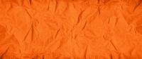 Orange crumpled paper texture. Banner background