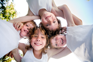 Happy children in white shirts in the sky