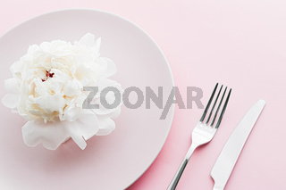 Dining plate and cutlery with peony flower as wedding decor set on pink background, top tableware for event decoration and dessert menu