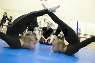 Belarus, Gomel, July 4, 2018. Indicative training circus school.Trainer coaches gymnasts.Sports teacher