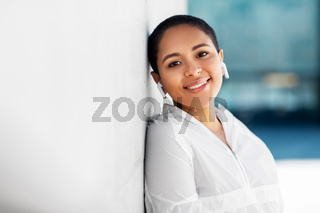happy african american woman with earphones