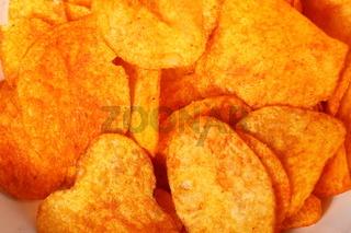 Close up potato paprika chips as background