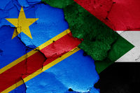 flags of DR Congo and Sudan painted on cracked wall