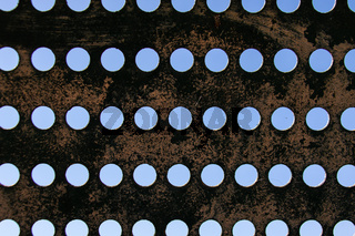 Metal structure with aligned holes. Grunge metal