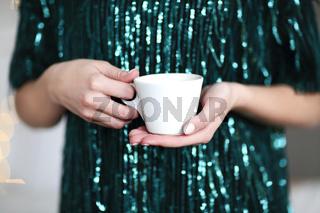 Young woman enjoying hot beverage