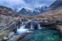 beautiful waterfalls Fairy Pools under the snowy mountains