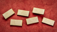 blank wooden blocks on red handmade paper