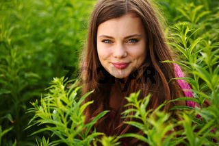woman in grass close up