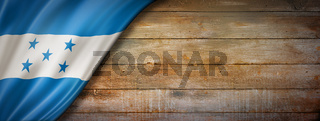 Honduras flag on vintage wood wall banner