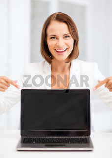 smiling woman with laptop pc