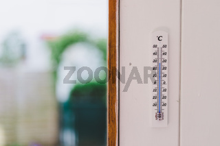 Heatwave: Thermometer in summer on a blurry background, heat